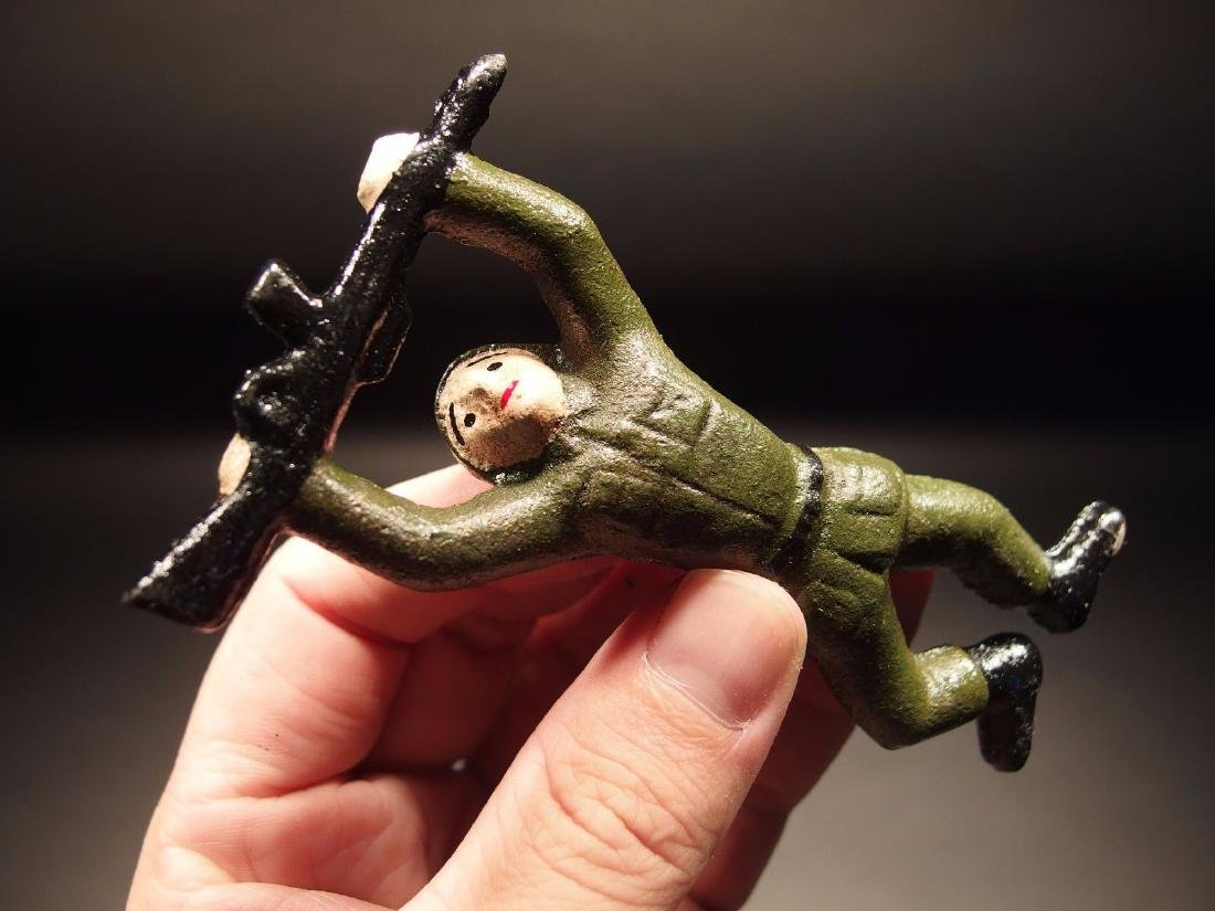 Vietnam Cast Iron Army Man Crawling Bottle Opener