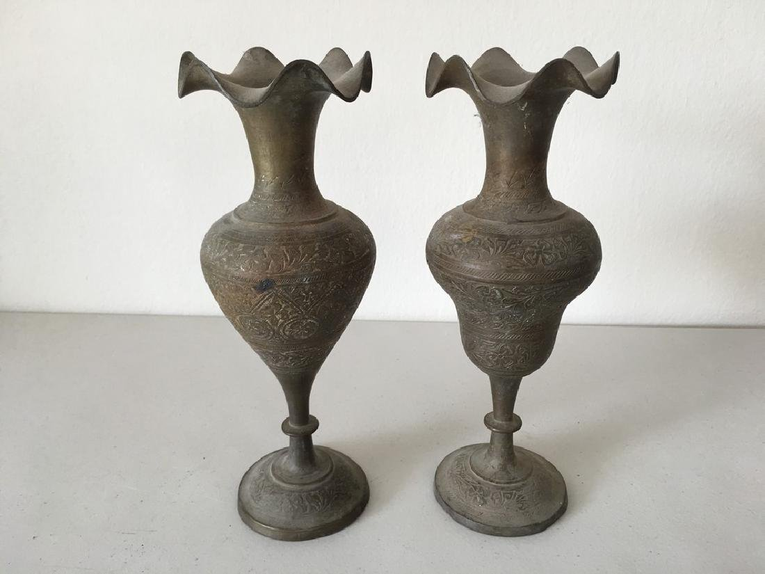 A Pair of Bronze Candle Stands