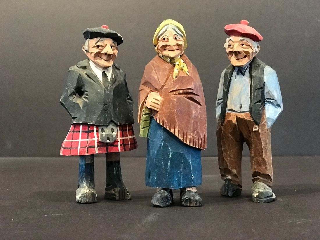 3 carvings of Man in a Kilt Woman in Shawl & Rustic Man