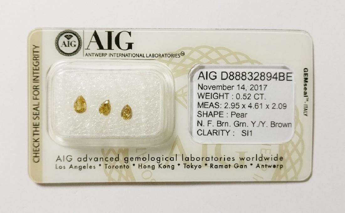 0.52 ct Pear cut diamond F.Brn.Greenish Yellow /