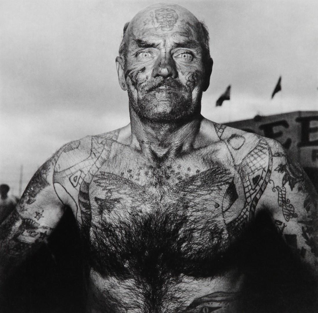 DIANE ARBUS - Tattoed Man at Carnival Maryland 1970