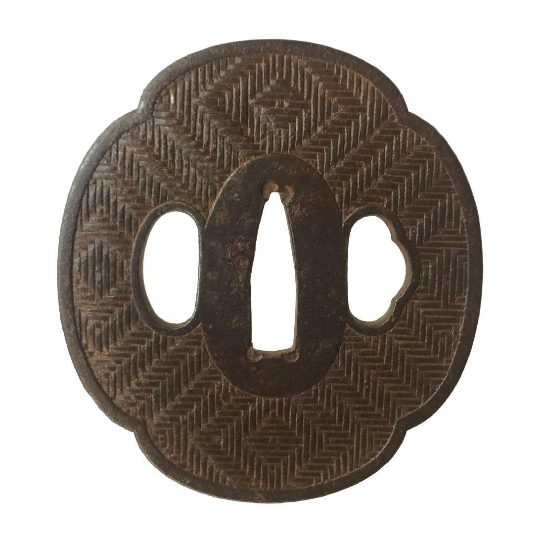 Iron tsuba with woven basket pattern