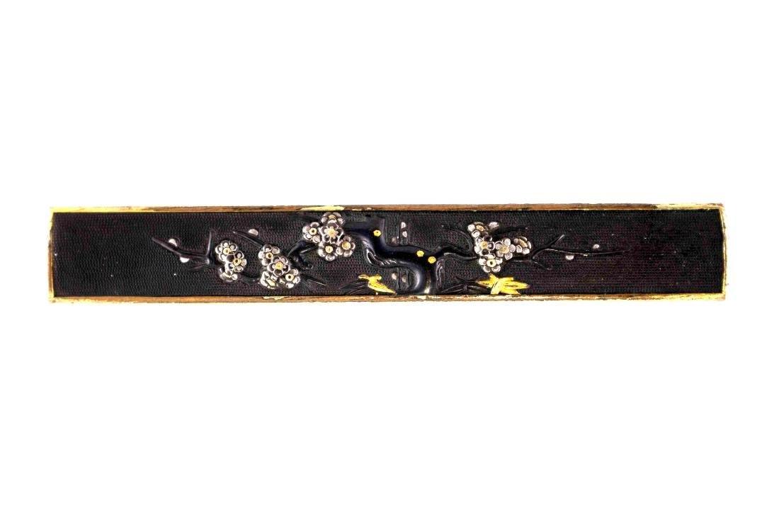 Shakudo kozuka (knife handle) carved and inlaid in gold