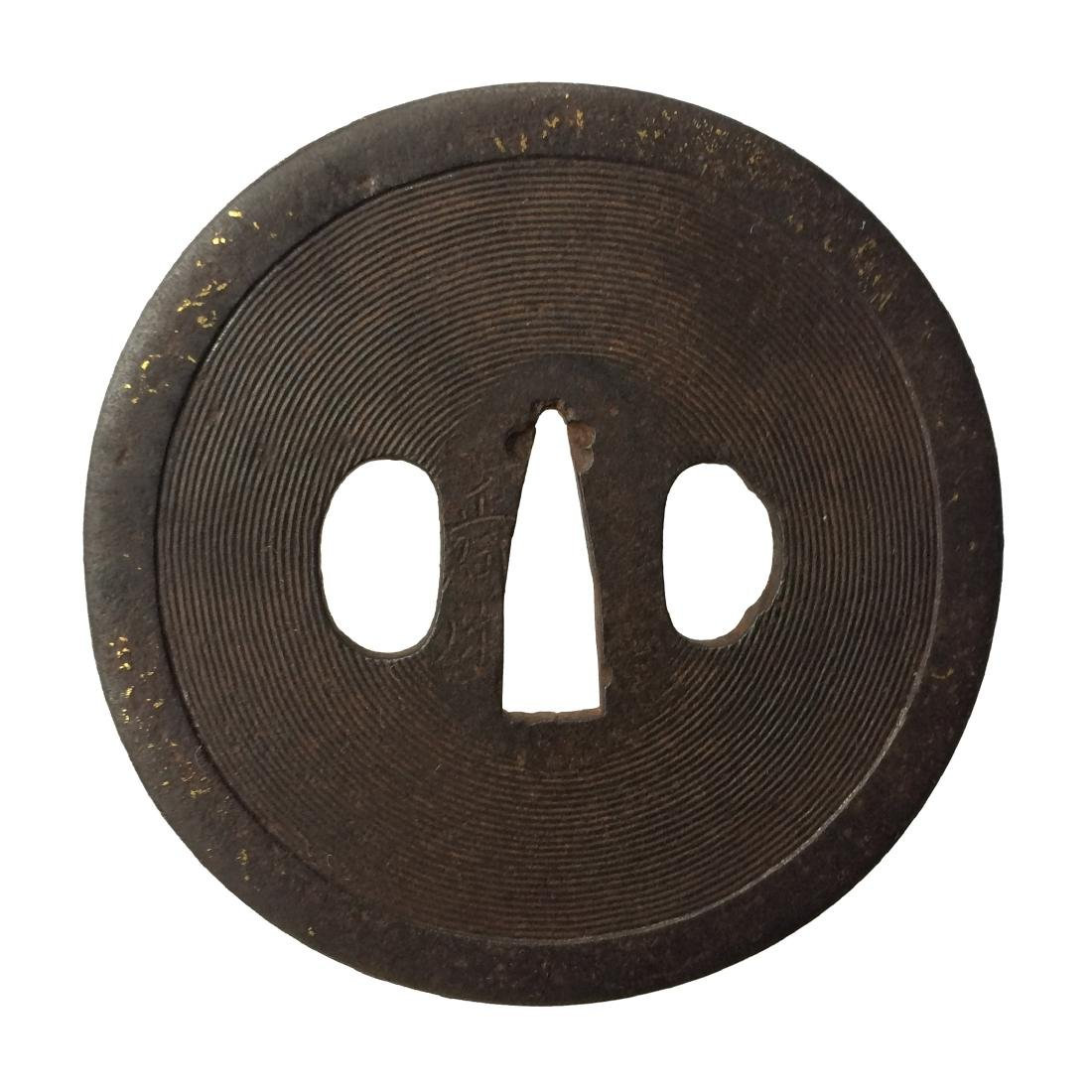 Signed iron tsuba carved with concentric circles