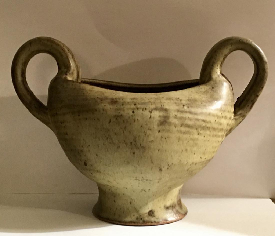 Double handle urn style mottled glaze vase