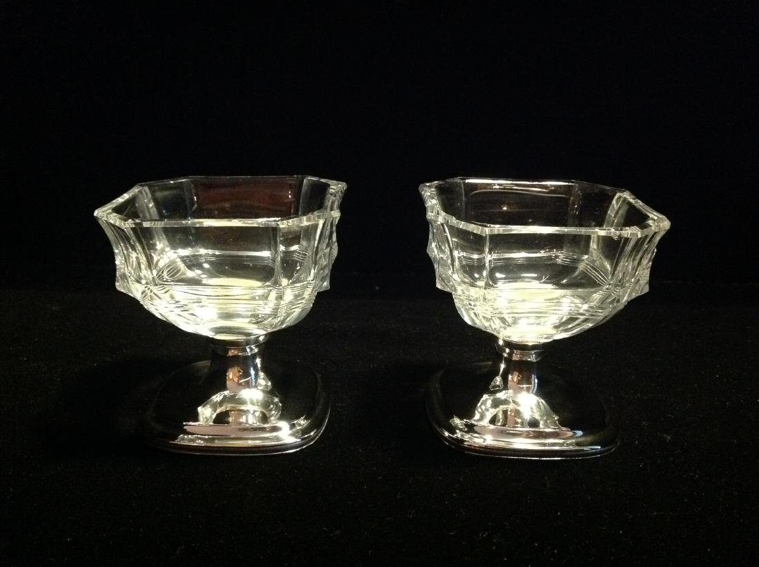 A pair of Crystal with Silver table salts