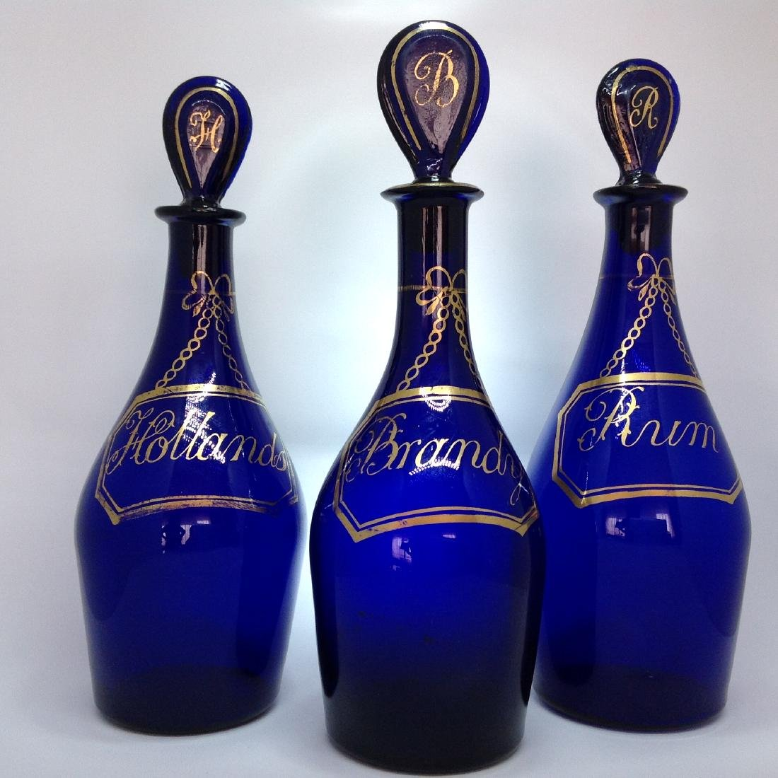 A set of Three Bristol blue glass by Isaac Jacobs,