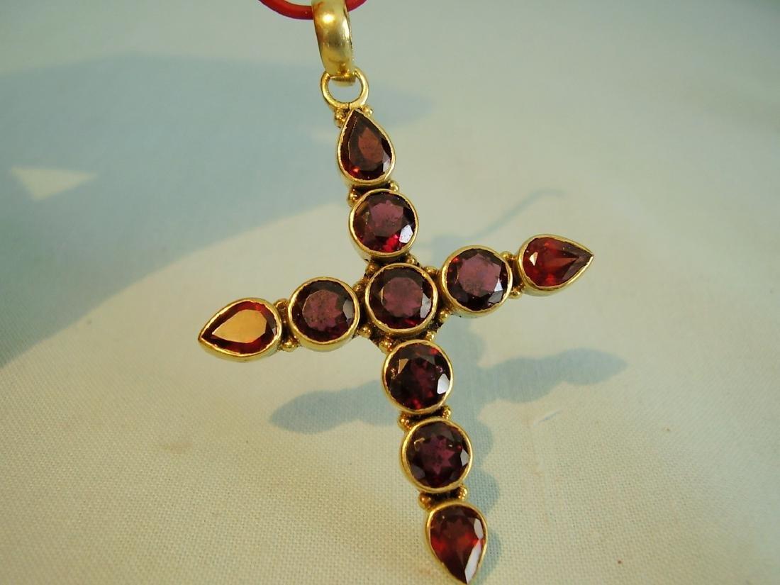 Pendant cross with garnets