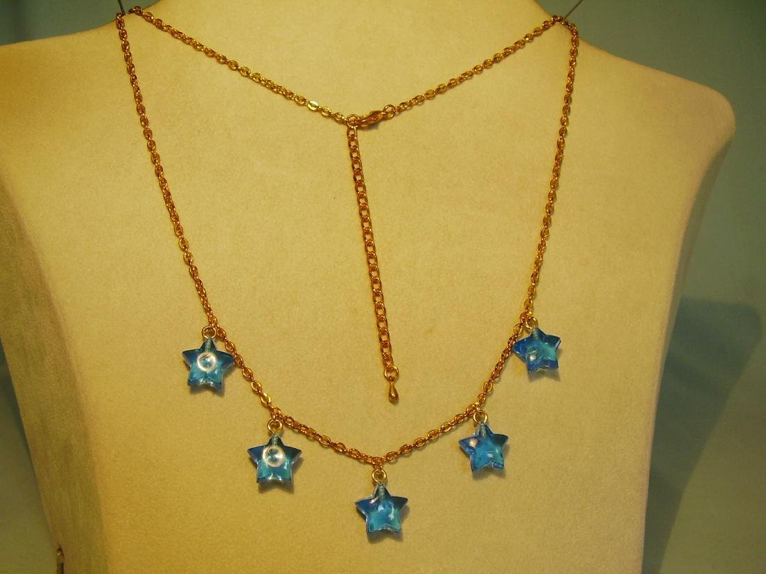 Necklace with blue stars on chain