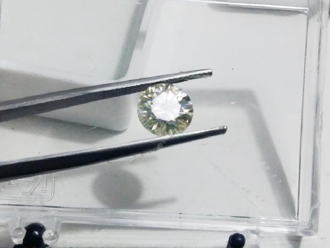 Man Made Round VS Moissanite - 5