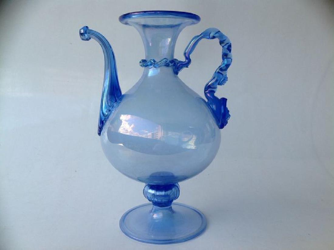 Venetian iridescent blue glass wine jug on foot,