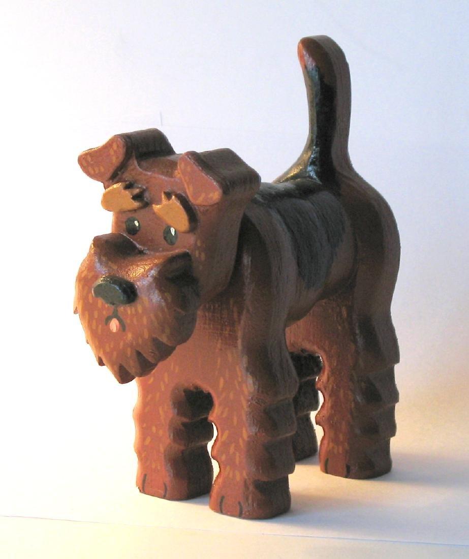 Folk art dog carving.