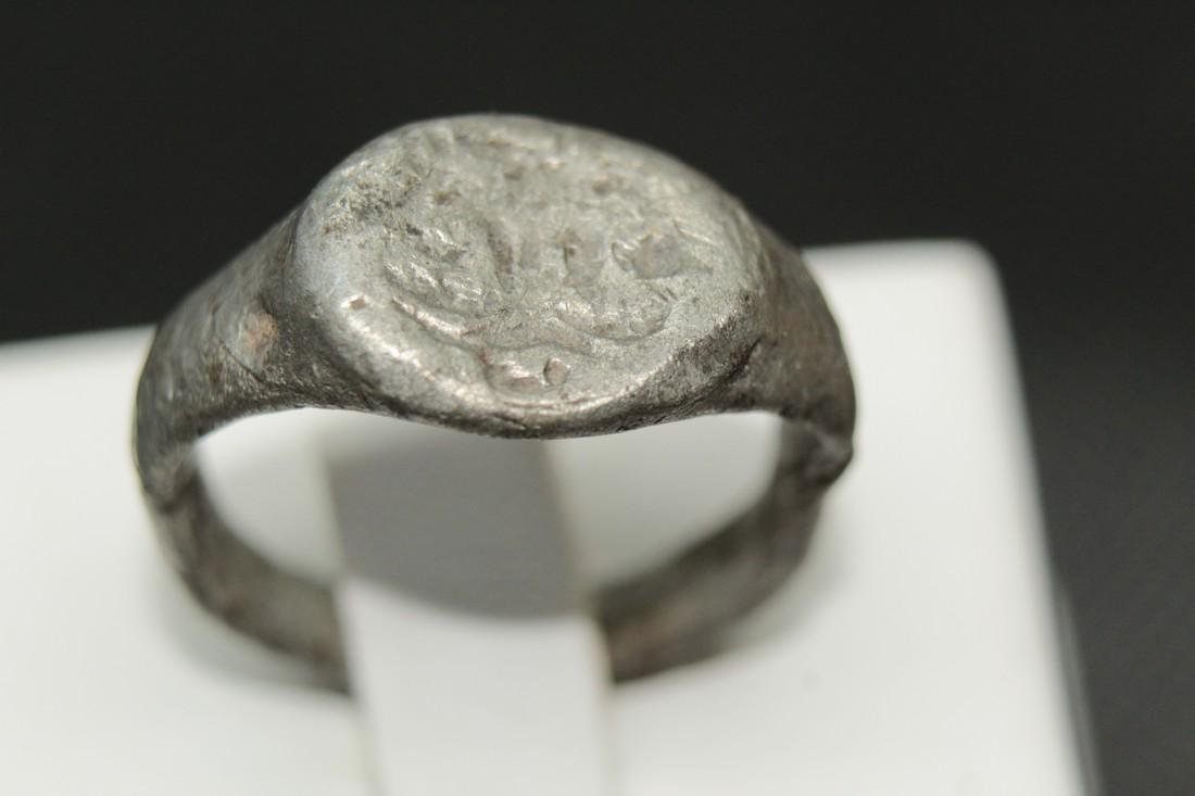 Late Medieval tin bronze ring with some animal