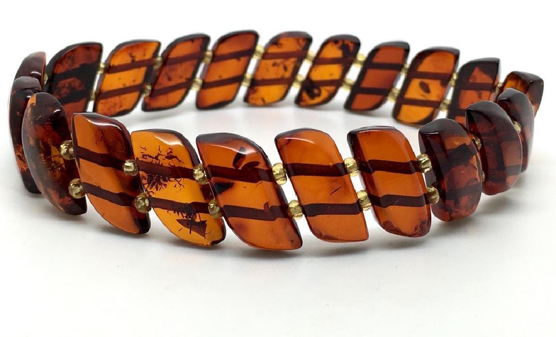 Braceleet hand carved Baltic amber slices cognac colour