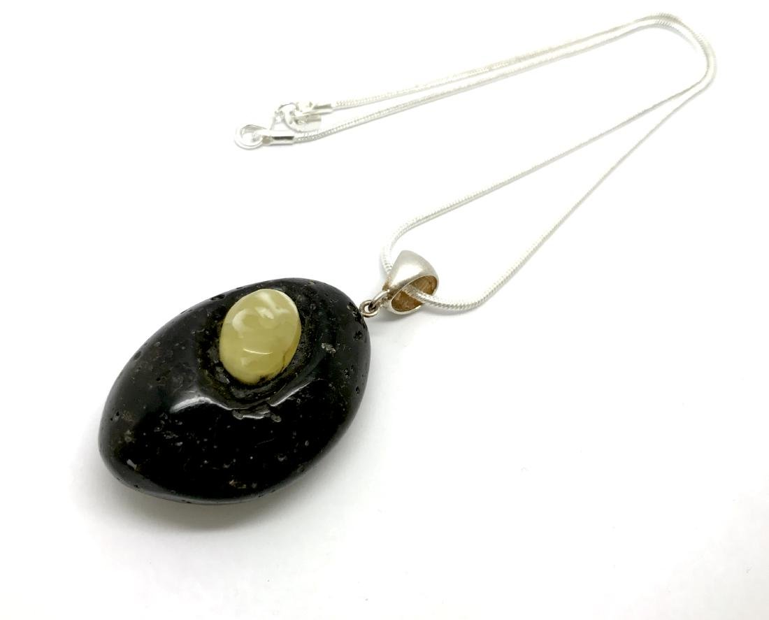 Vintage pendant amulet Baltic amber silver and chain