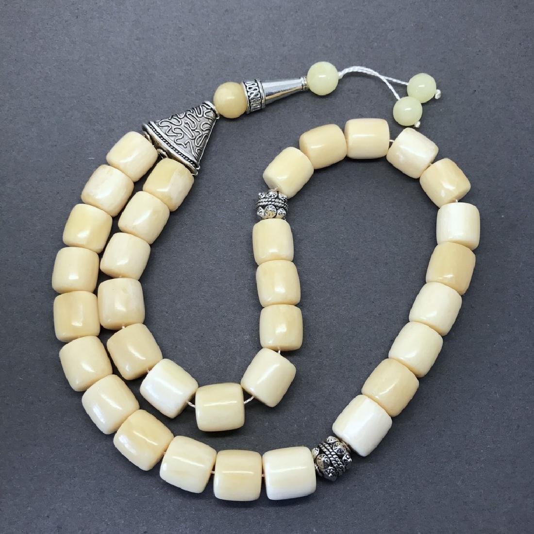 Tesbih rosary 33 Baltic amber beads barrel 12x13mm 75