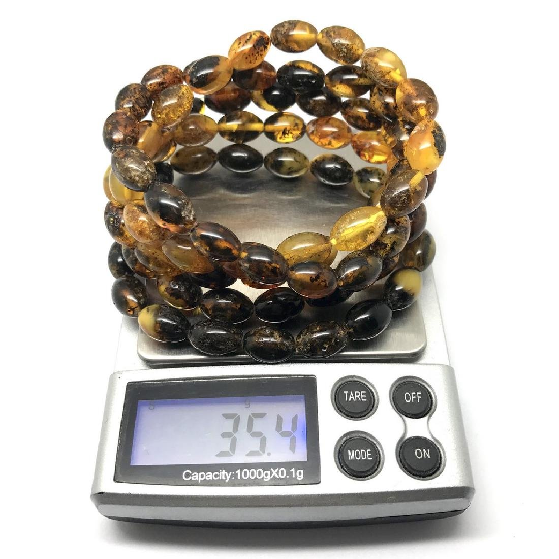 5x Bracelet Baltic amber hand cut beads olive shape 35 - 7