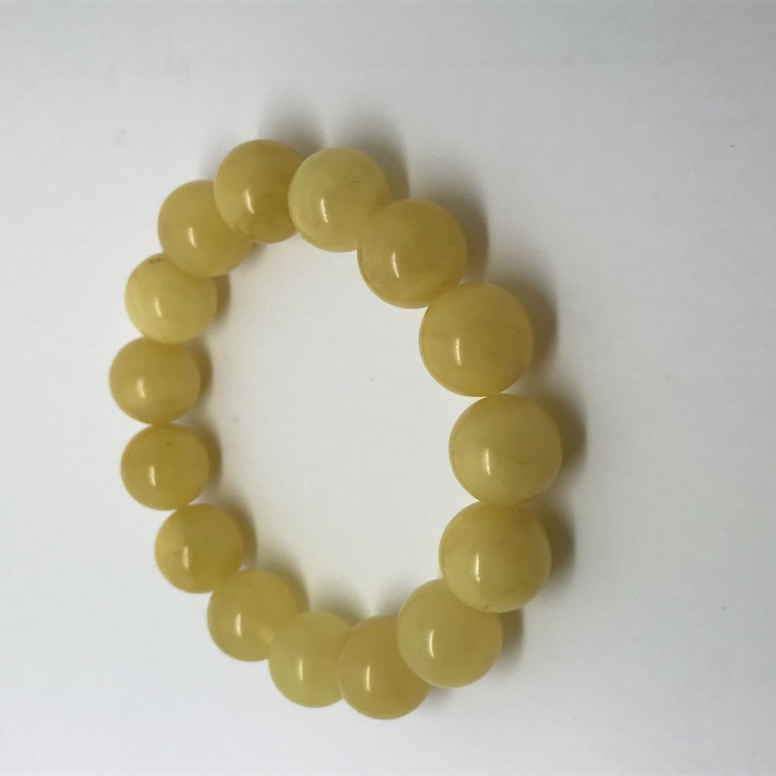 Bracelet Baltic amber butter colour beads ø13mm 18.1 - 6