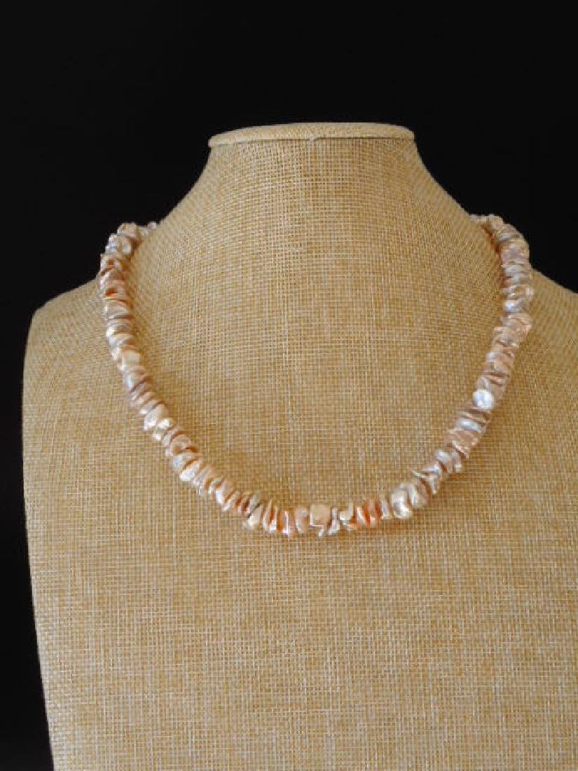 Pearl necklace of pink baroque cultivated Keshi - 2
