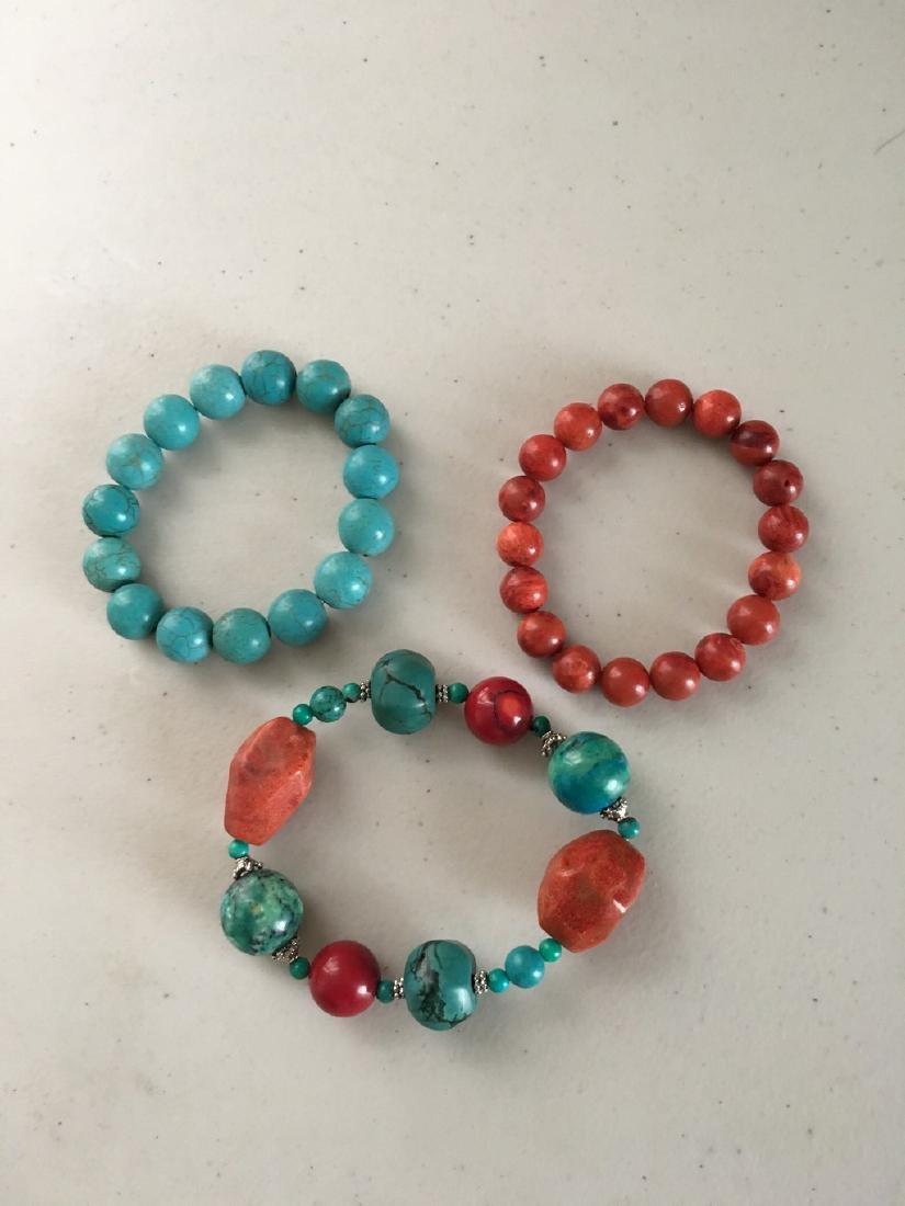 a set of turquoise/sarcandra glabra bracelace