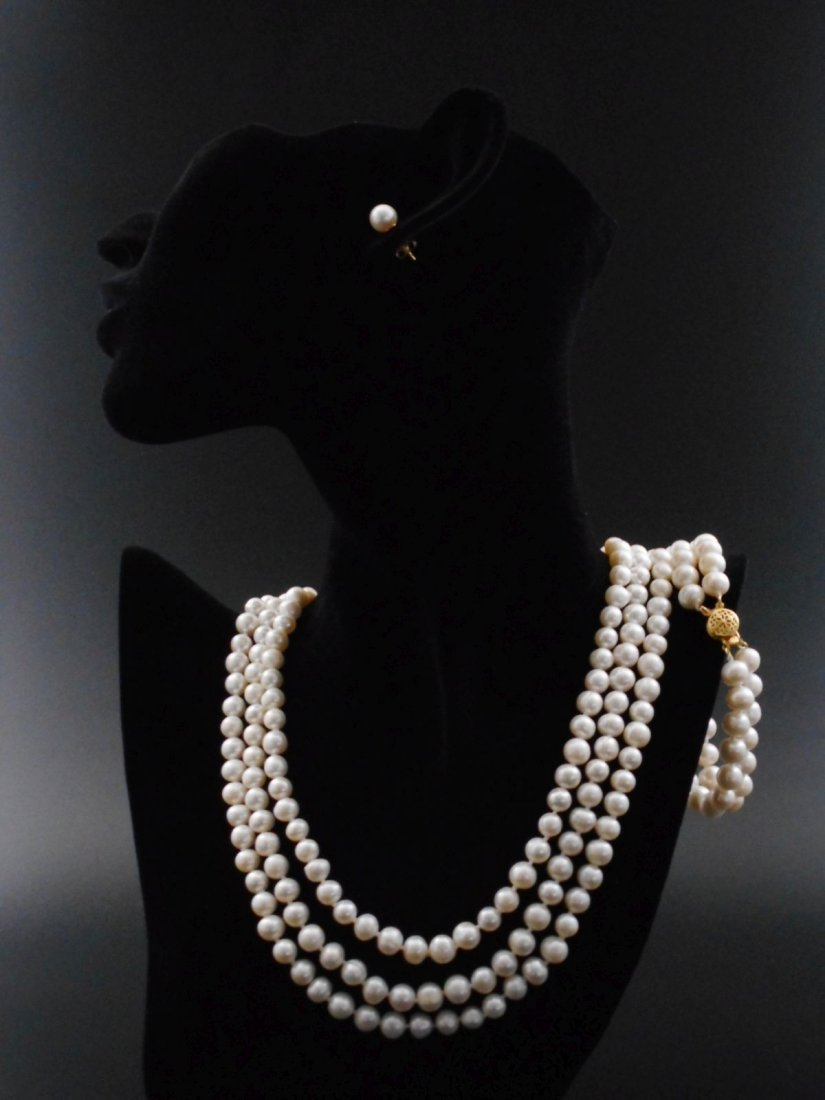 Set of triple strand pearl necklace, earings and