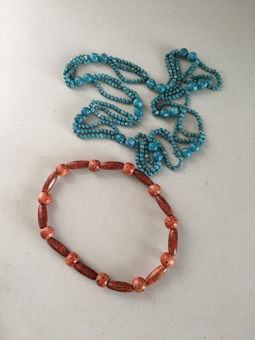 a set of turquoise/egypt wood necklace