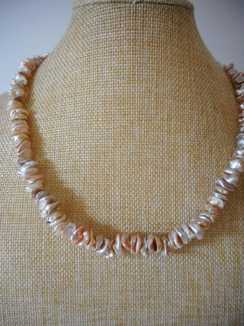 Pearl necklace of pink baroque cultivated Keshi - 4