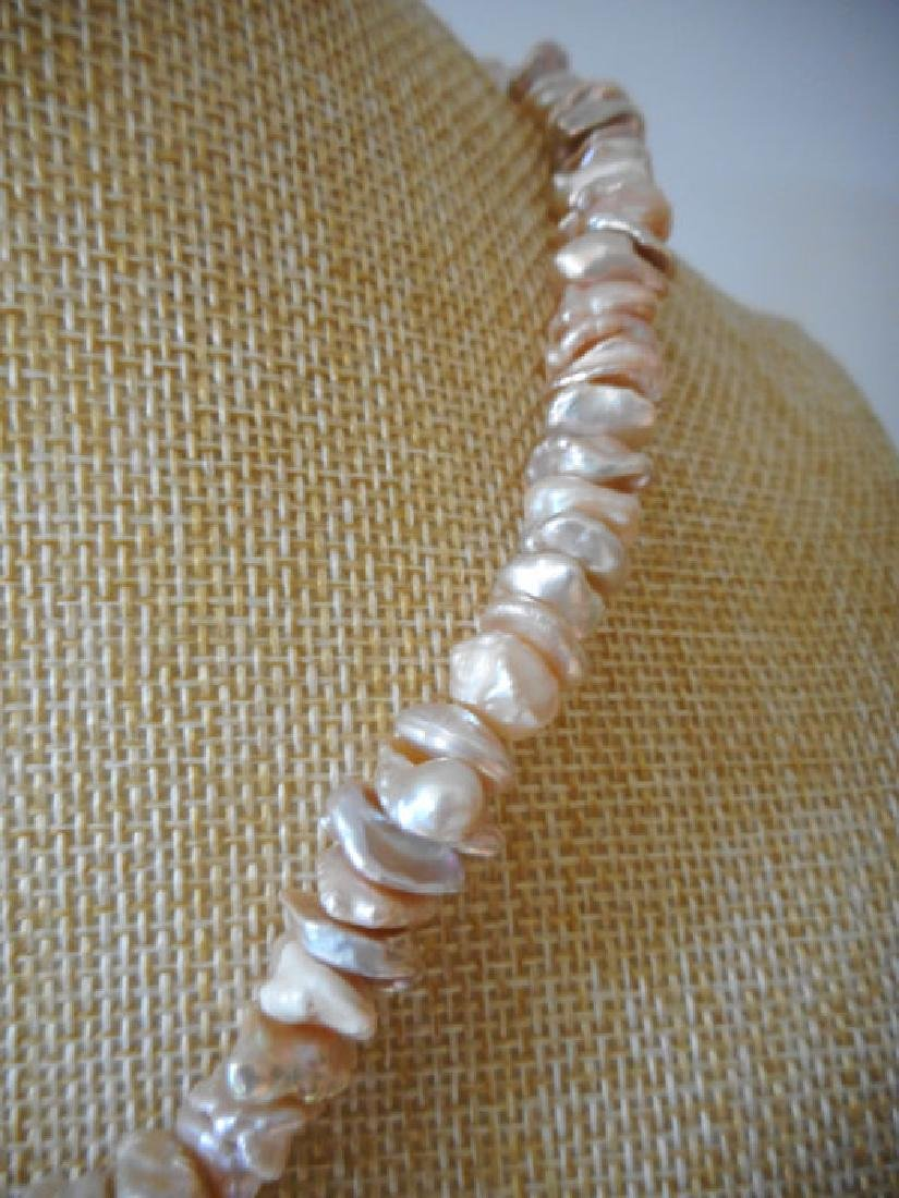 Pearl necklace of pink baroque cultivated Keshi - 7