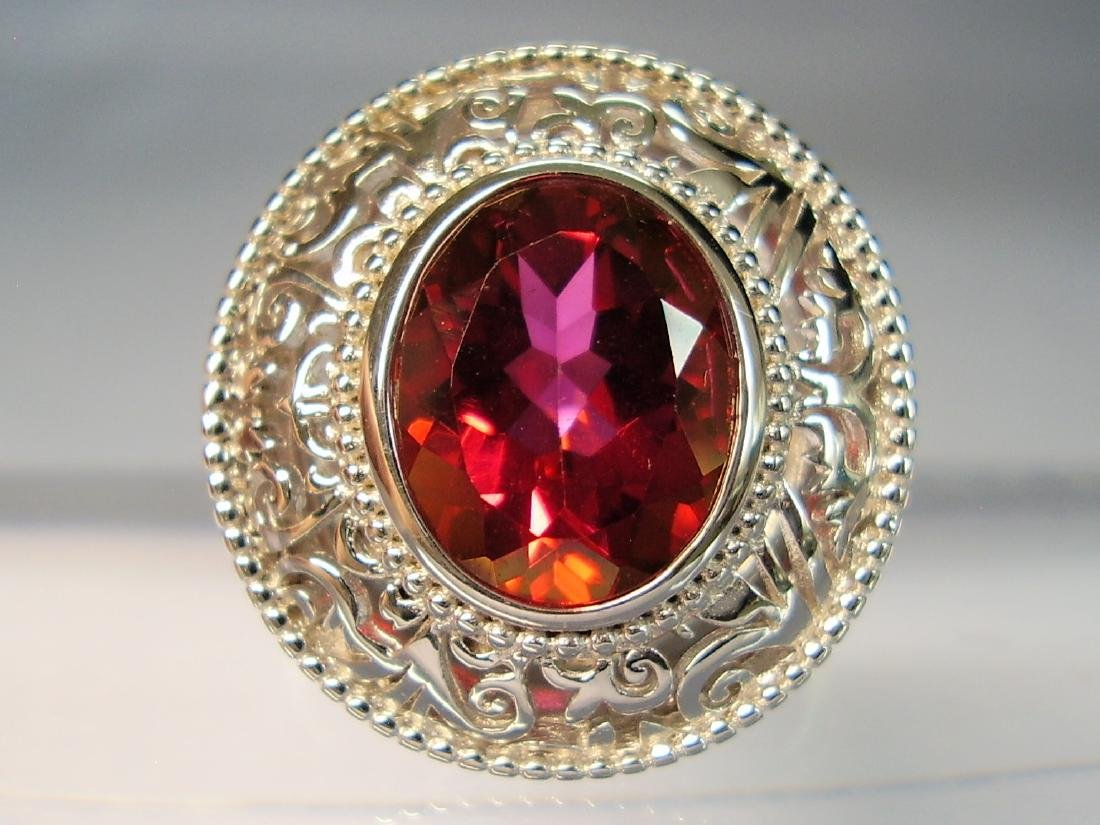 Ring with red Topaze faceted