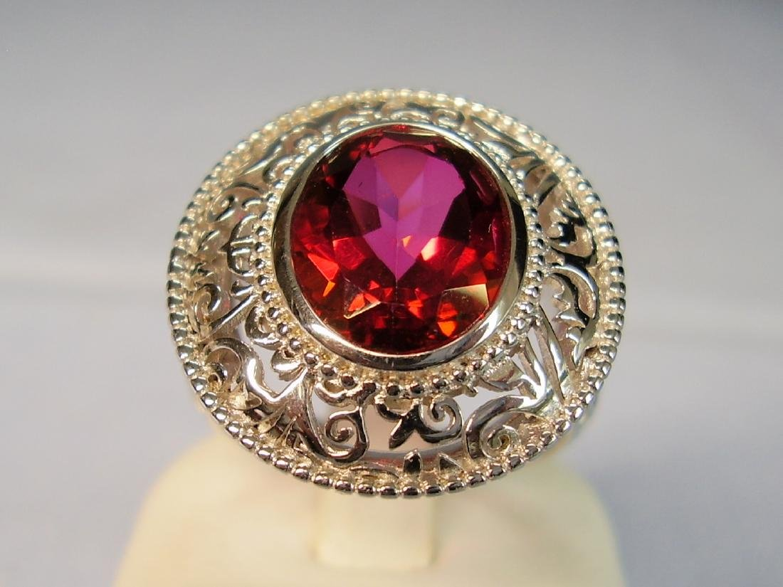 Ring with red Topaze faceted - 2