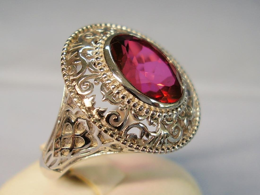 Ring with red Topaze faceted - 5