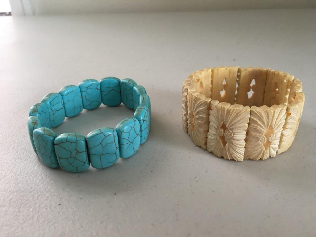 a set of turquoise/bone bracelace