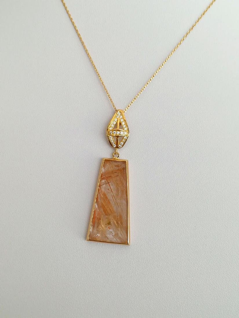 19.2 carats with gold pendant with rutilated quartz