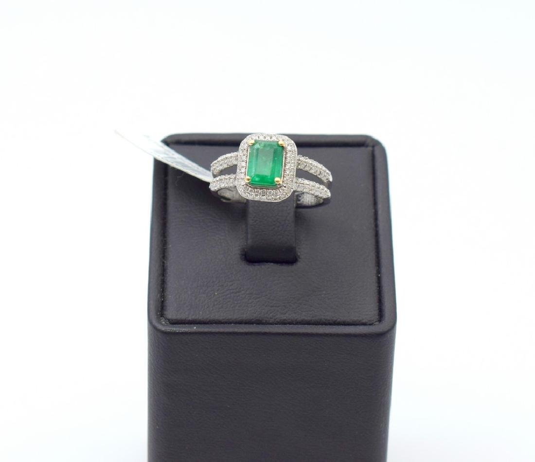 18 carat white gold ring with diamond and emerald stone