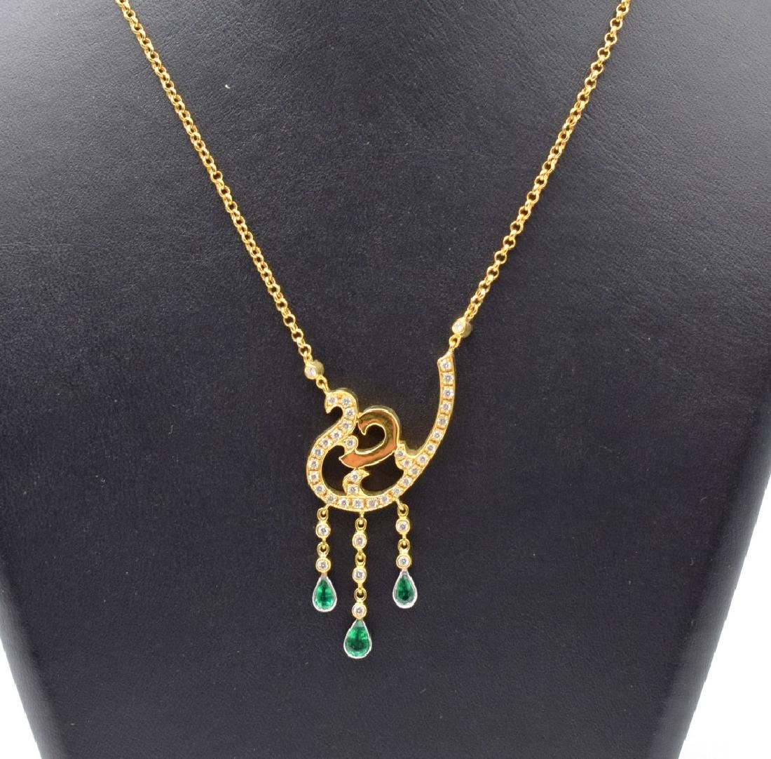18 carat yellow gold necklace with diamond and emerald
