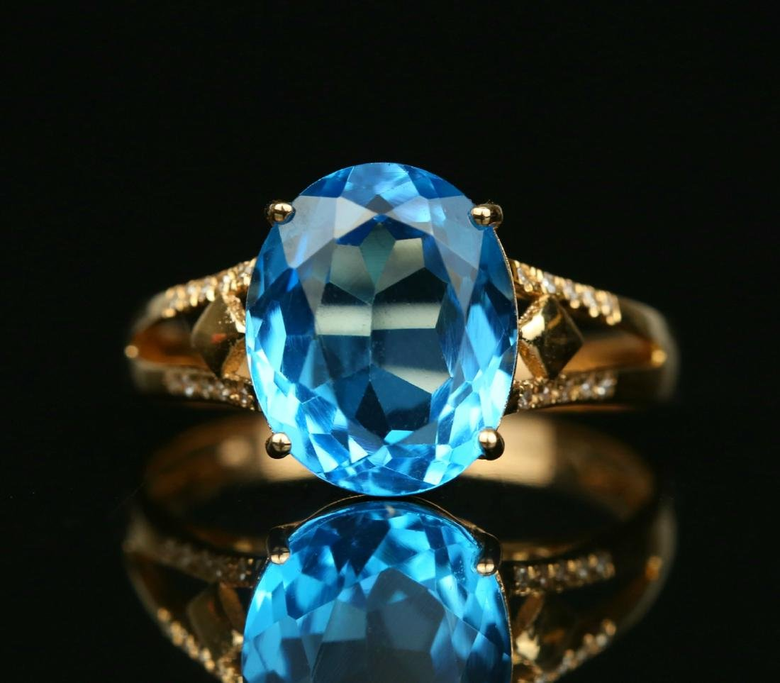 18KT rose gold ring with blue topaz 6.0ct.
