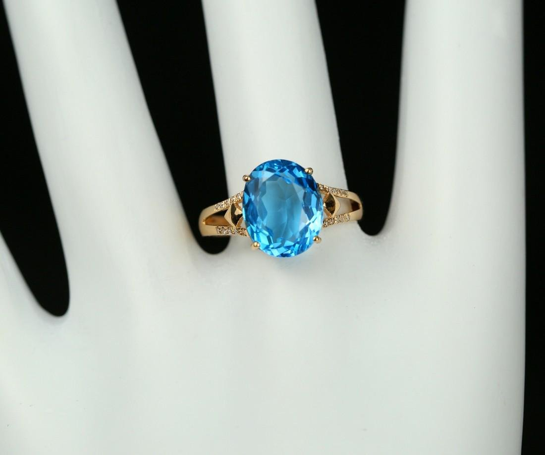18KT rose gold ring with blue topaz 6.0ct. - 7