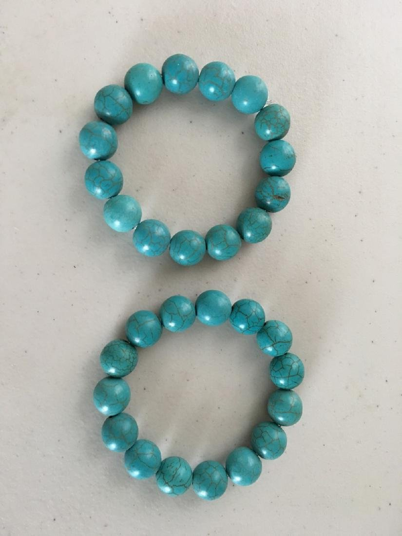 a set of two turquoise bracelace