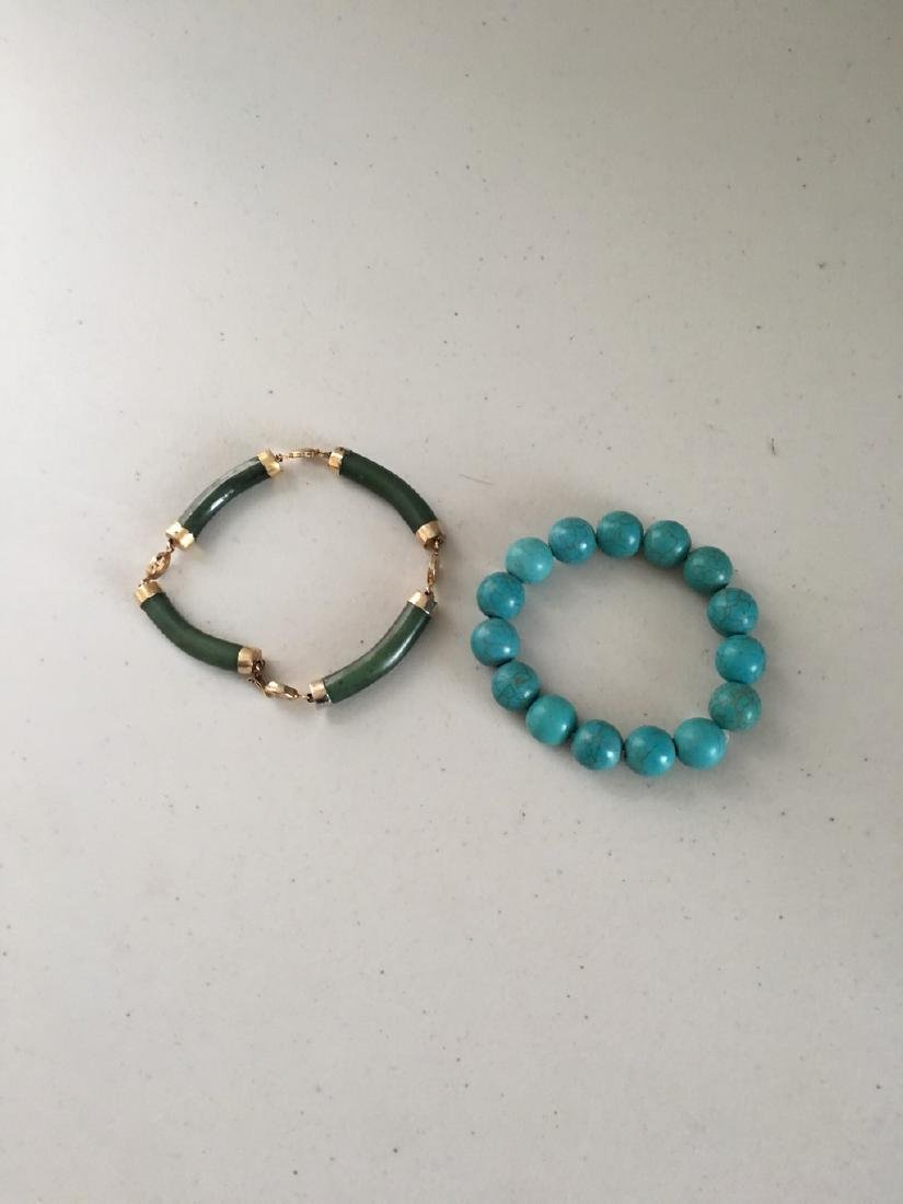 a set of turquoise/jade bracelace