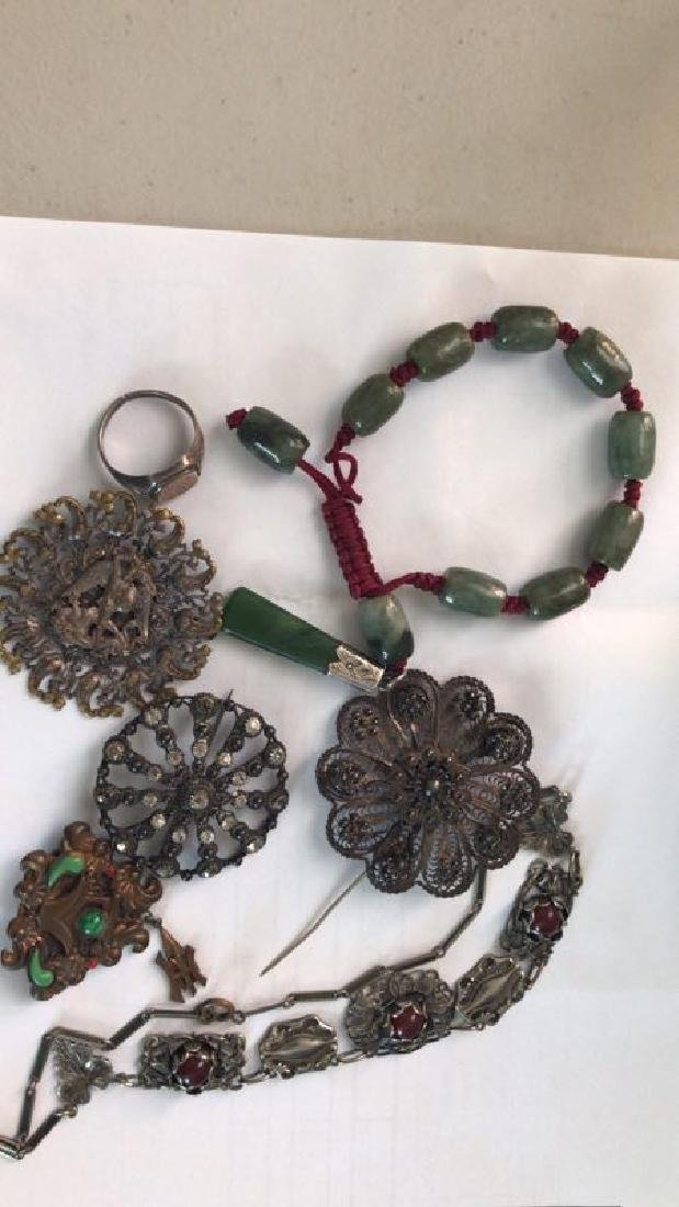 a set of jewleries pin with jade items