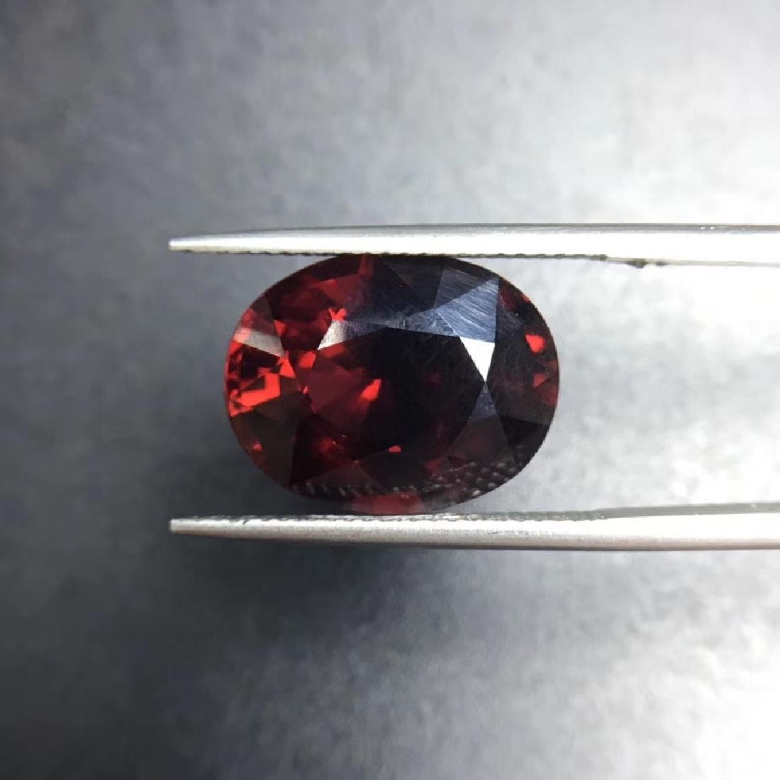 12.09 ct Garnet 12.0*15.4 mm Oval Cut