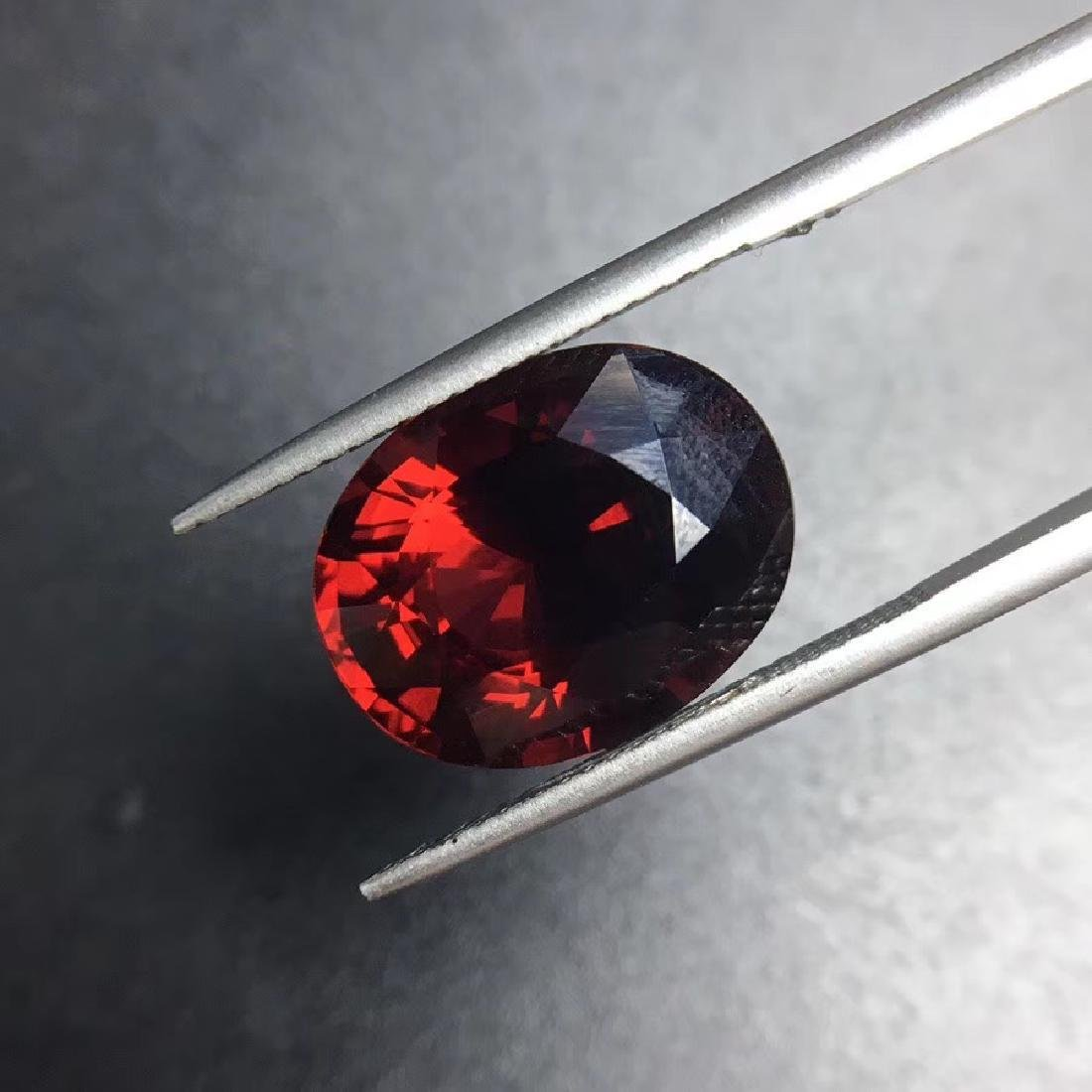 12.09 ct Garnet 12.0*15.4 mm Oval Cut - 3