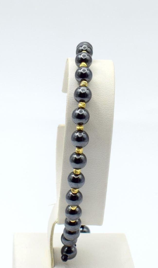 14 carat yellow gold pandora style bracelet with