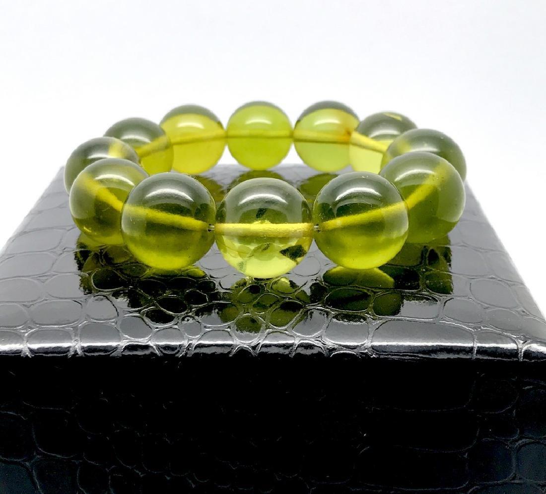 Cut green amber beads bracelet 24.6 gr