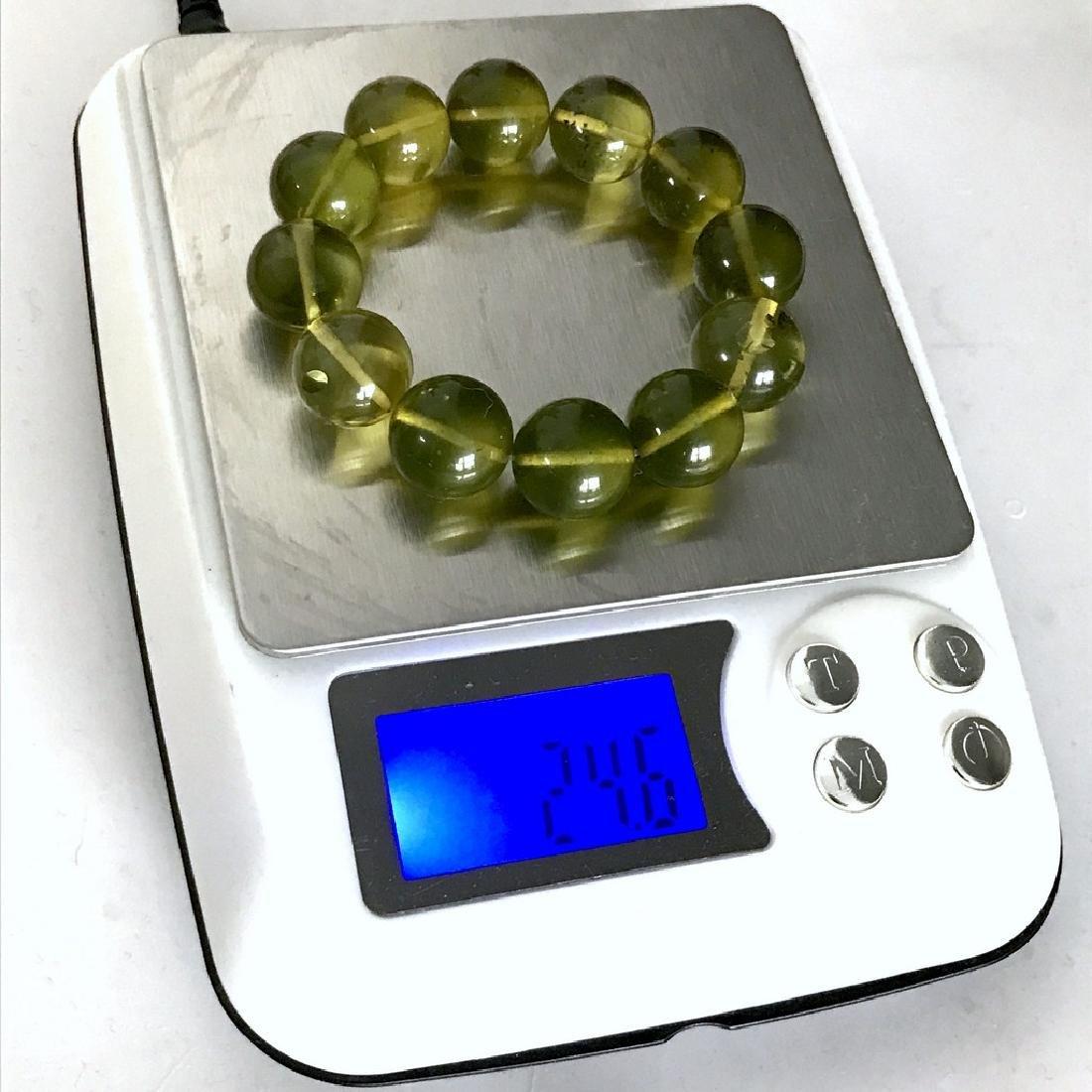 Cut green amber beads bracelet 24.6 gr - 7
