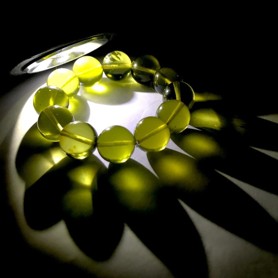 Cut green amber beads bracelet 24.6 gr - 8