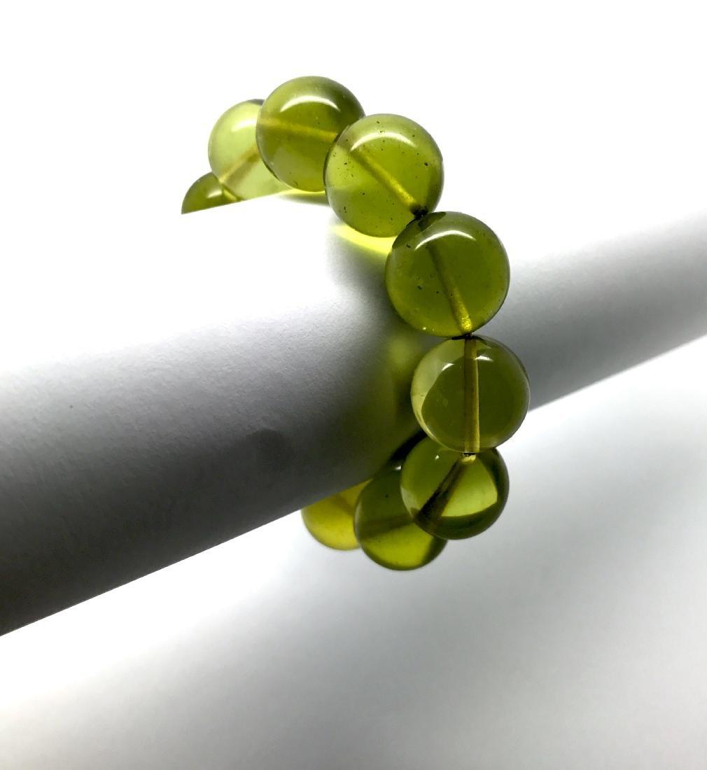 Cut green amber beads bracelet 24.6 gr - 9