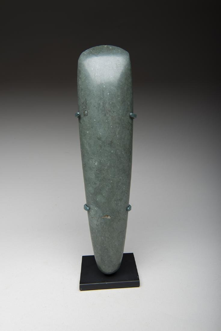 Large and important blue green jade celt used by lord