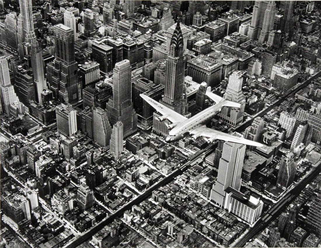 MARGARET BOURKE-WHITE - DC-4 flying over Manhattan