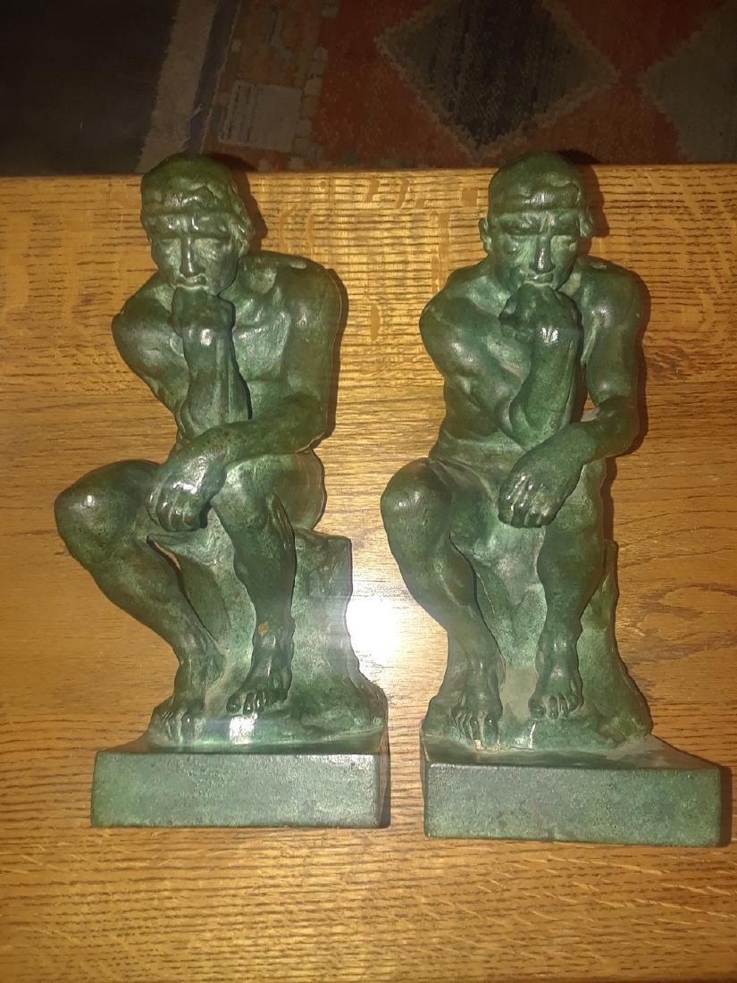Pompeain bronze company thinker book statues